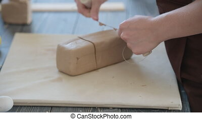 White clay preparation for work. Cutting layers of clay ...