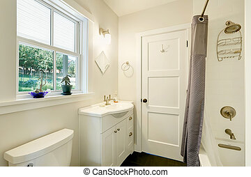 White clean bathroom interior. Small vanity cabinet with a sink