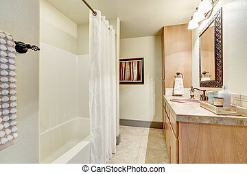 White clean bathroom interior with modern maple cabinets