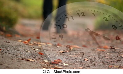 White clock and fallen leaves