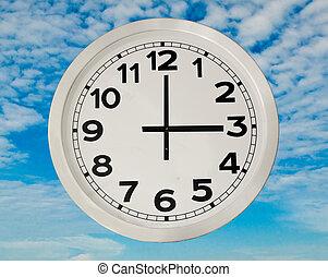 White Clock  isolated on blue sky background