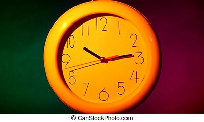 white clock on colorful background