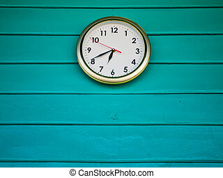 White clock on Green wall