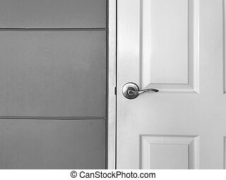 White close wooden door and gray wall, black and white tone