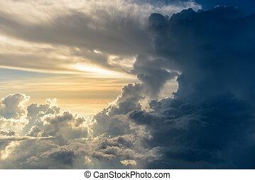 White cloud against dark storm cloud in the sky
