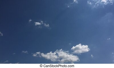 White cloud disappear in the hot sun on blue sky. Cumulus...