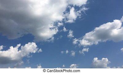 White cloud disappear in the hot sun on blue sky. Cumulus...