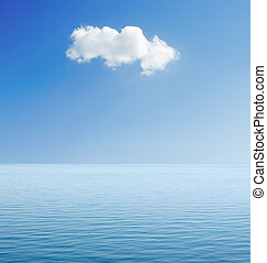 white cloud in blue sky over sea