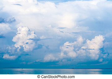 white cloud in summer clear blue sky background over sea