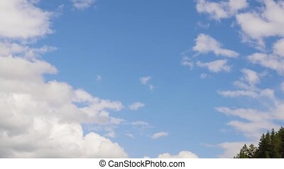 white cloud running across the blue sky, rolling puffy cloud...