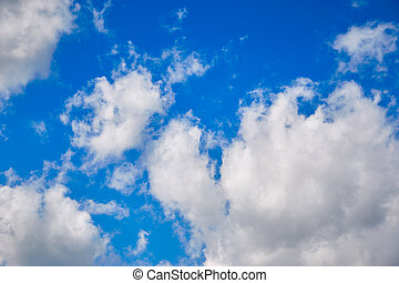 white clouds against the blue spring sky