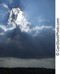 White clouds and sun rays. Blue sky.