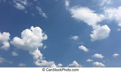 White clouds disappear in the hot sun on blue sky....