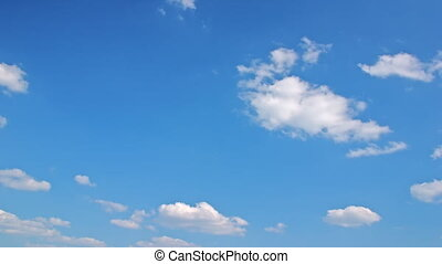 White clouds flying on blue sky - motion background...