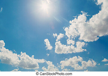 white clouds in the blue sky and sun