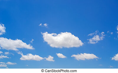 white clouds in the blue
