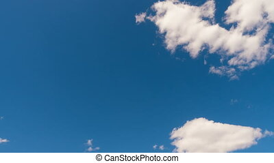 white clouds on a blue sky timelapse