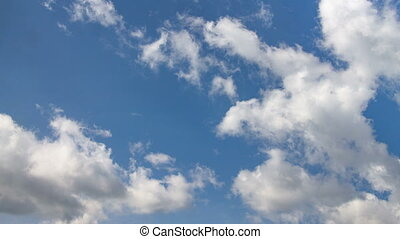 White clouds on blue sky in the summer day