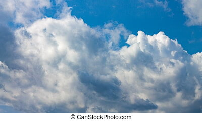 White clouds on blue sky in the sunny day