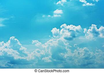White clouds on dark blue sky in a sun day