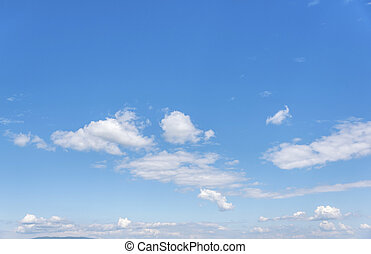 White clouds on the blue clear sky.
