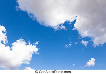 White clouds over a beautiful blue sky