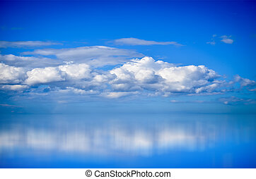 White Clouds over Blue Sea