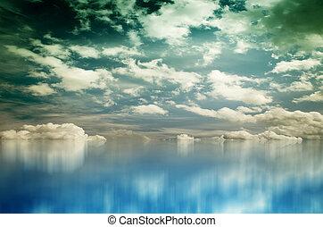 White Clouds over Blue Sea