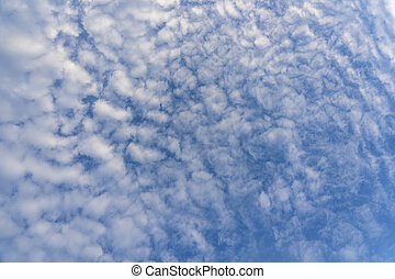 White clouds over blue sky. Background sky with clouds.