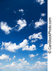 white clouds over blue sky.