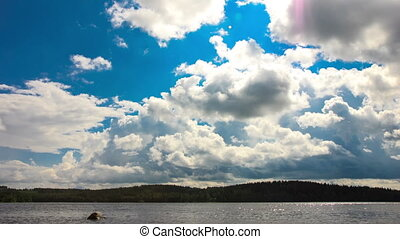 White Clouds over the Lake