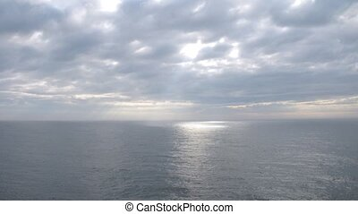 White clouds pass above ship at open sea, time lapse