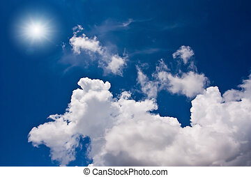 White cloudy blue sky and sun