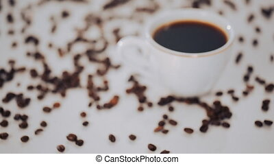 white coffee Cup and coffee beans on white background