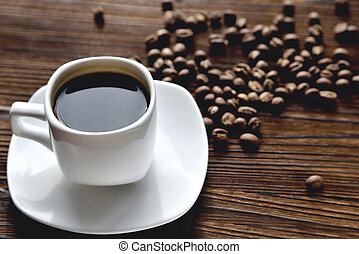 white coffee cup, morning side light coffee beans, natural wooden background
