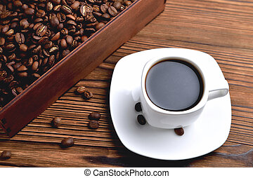 white coffee cup, morning side light coffee beans wooden box with coffee, top view natural wooden background