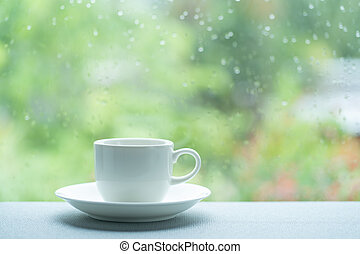 White coffee cup on a rainy day