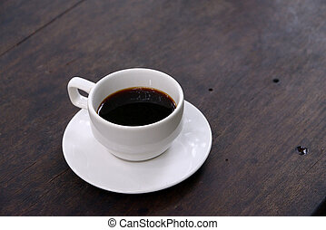 White Coffee Cup on a Wooden Table