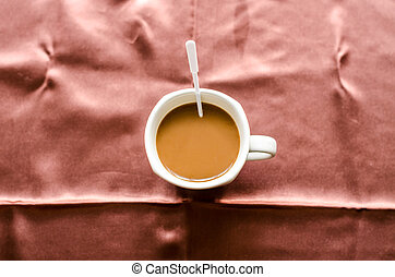 white coffee cup on background in the morning