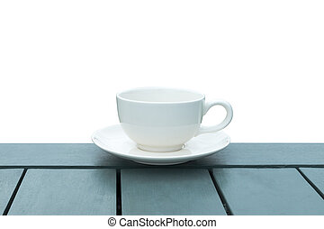 White coffee cup on green wood with white background.