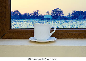 cup on the windowsill