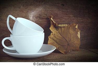 White coffee cup on wood board background,still life