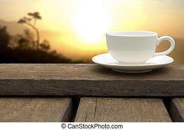 White coffee cup on wood floor.