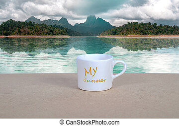 White coffee cup on wood table with nature background.