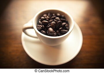 White Coffee Cup with Coffee Beans - A white cup on a white...