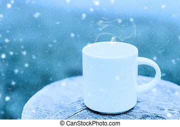 White coffee mug in the winter.
