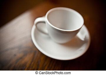 white coffee mug on white plate - An empty white coffee mug...