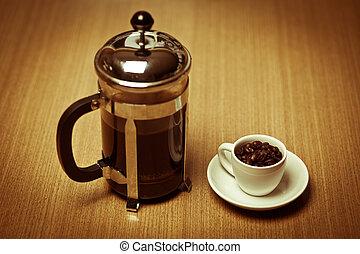 white coffee mug on white plate w/ french press - A white...
