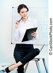 white collar - Image of a young businesswoman working at the...