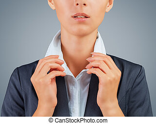 White collar worker - Unrecognizable woman in a suit holding...